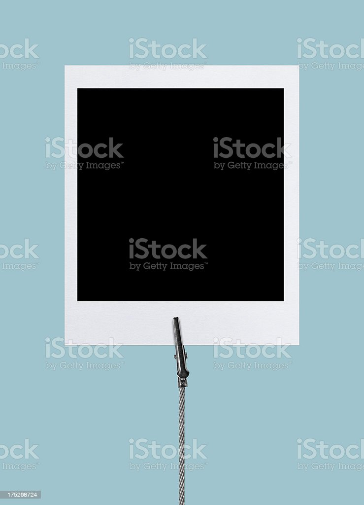 Instant Film in Wire Clamp (Clipping Path) stock photo