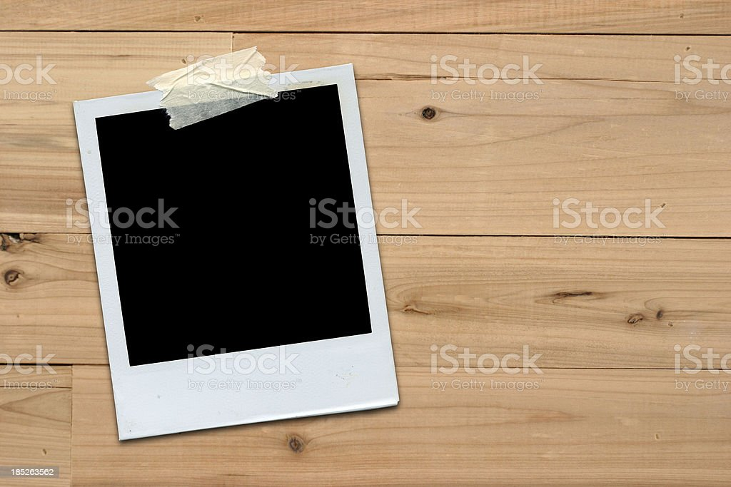 Instant Film on Wooden Wall royalty-free stock photo