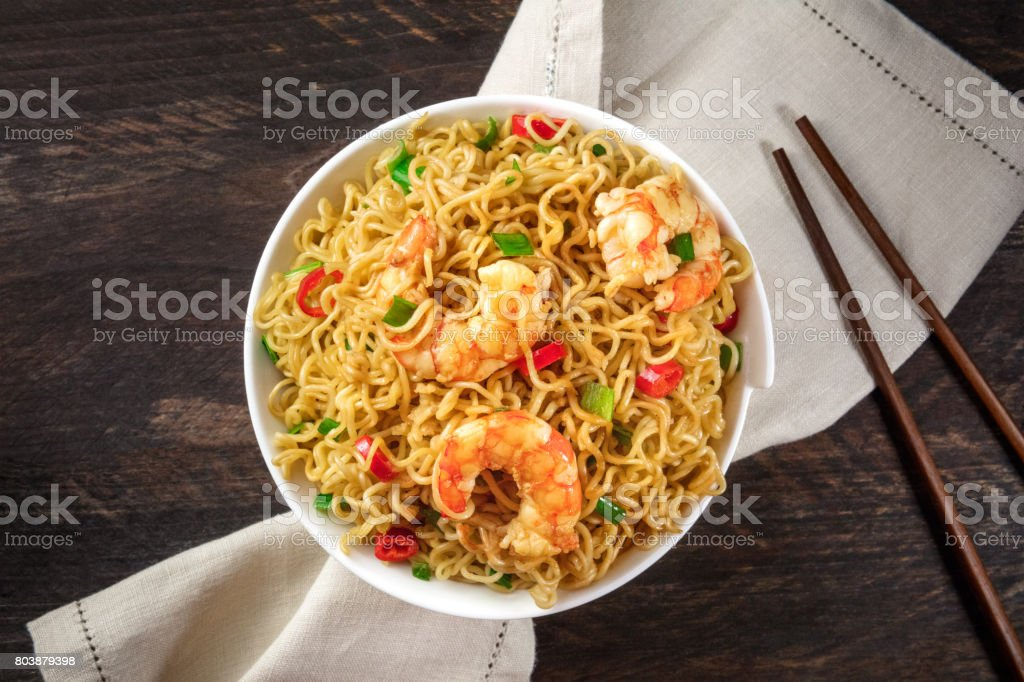 Instant noodles with vegetables and shrimps, plus copyspace stock photo