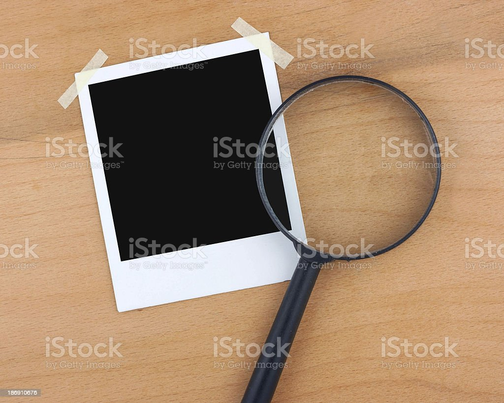 Instant photo and magnifier royalty-free stock photo