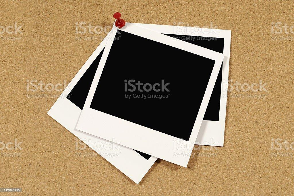 Instant photo prints on cork royalty-free stock photo