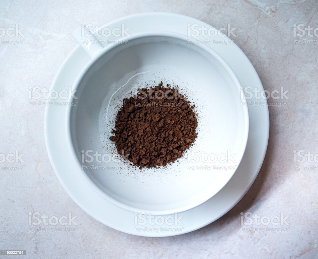 Instant/Dried Coffee Granules in a Coffee Cup Overhead View royalty-free stock photo