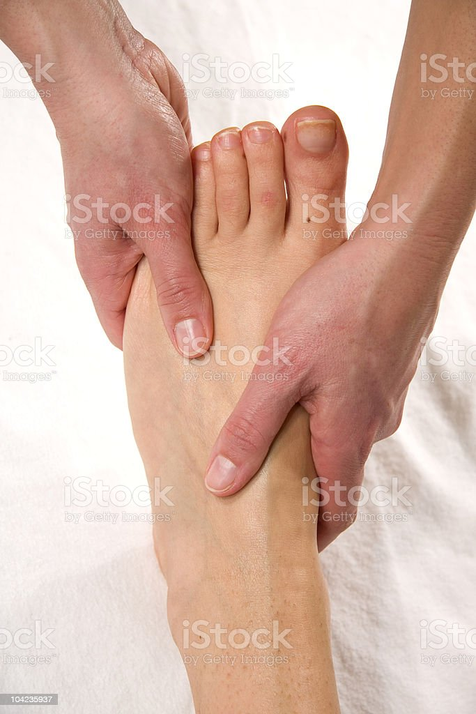 instep massage stock photo