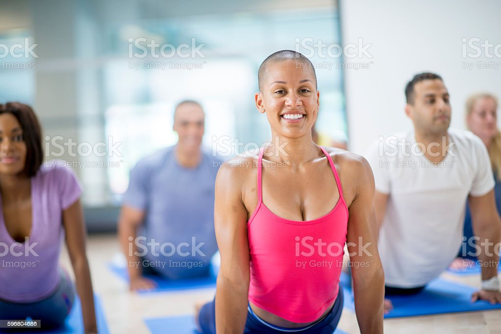 Instructor Leading a Yoga Flow stock photo