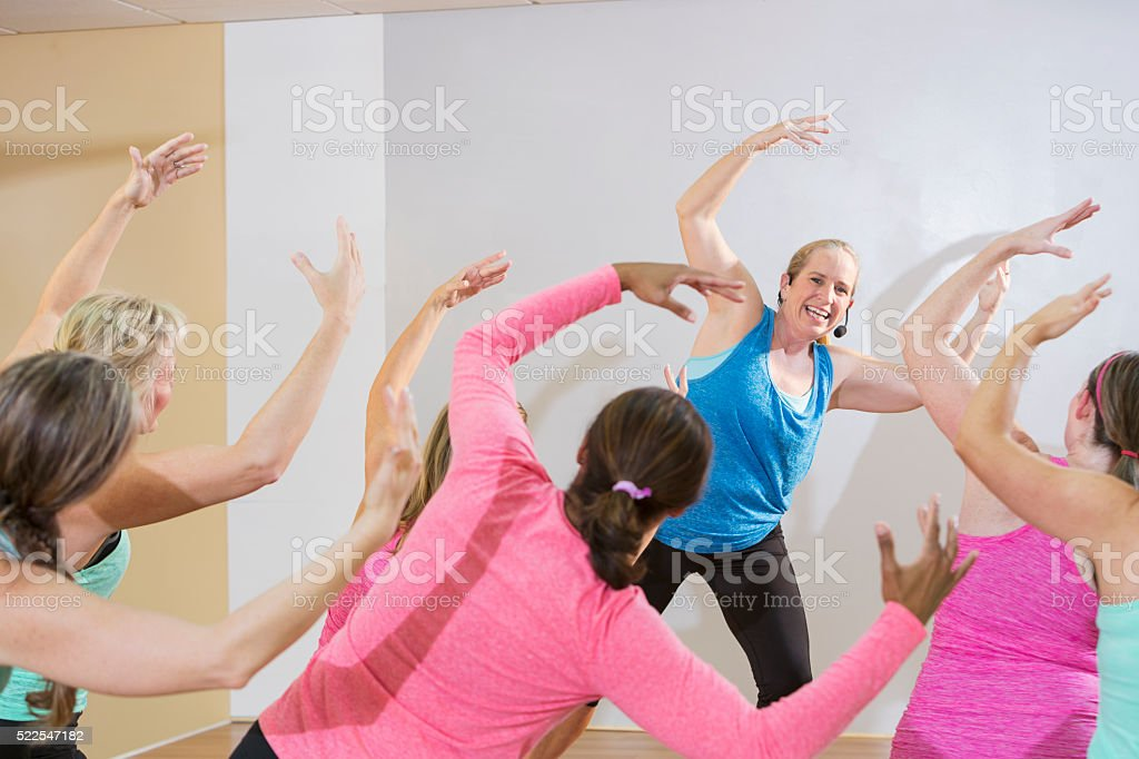 Instructor leading an exercise or dance class stock photo