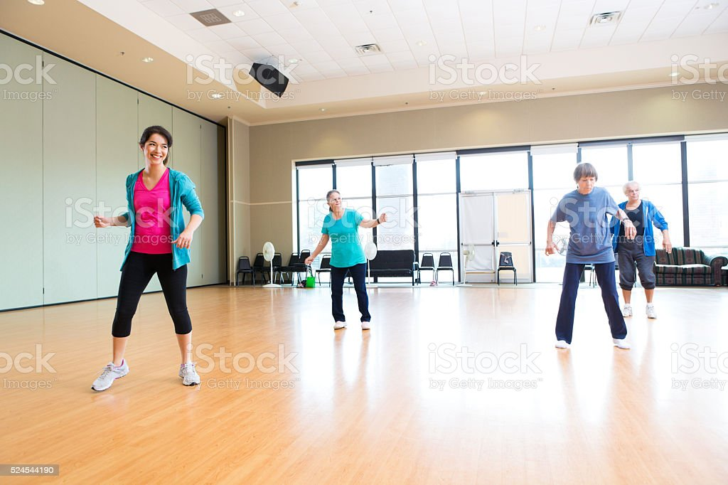 Instructor leading dance class at senior center stock photo