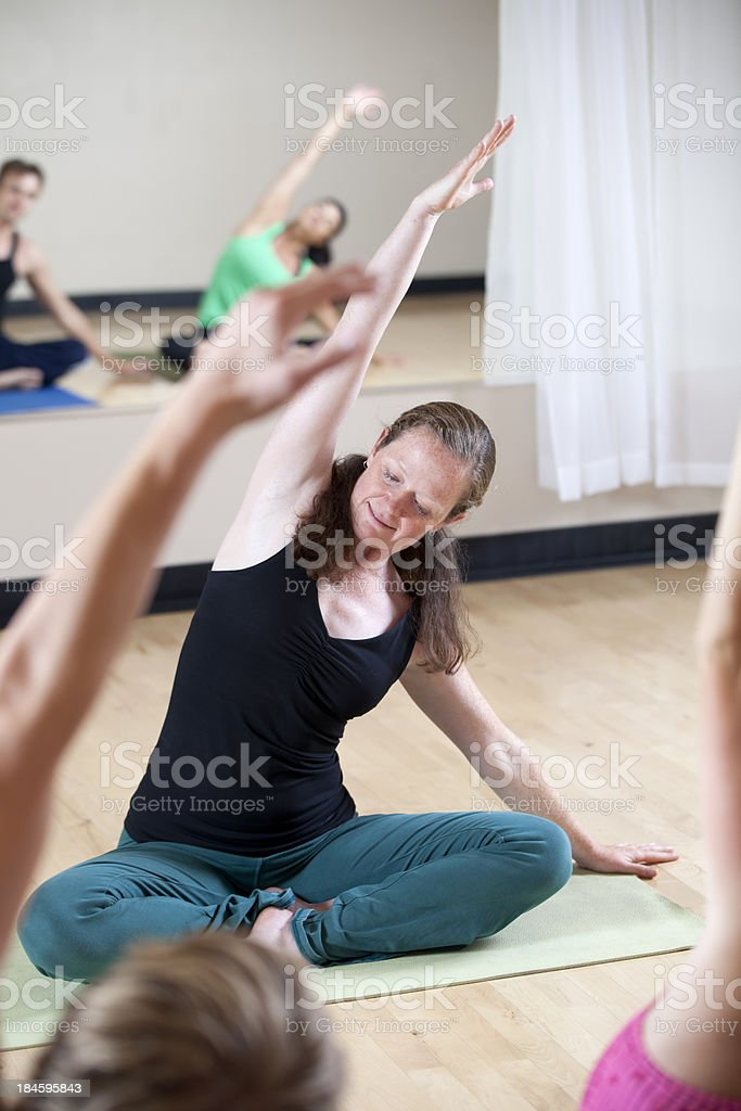 Instructor Leading Yoga Class stock photo