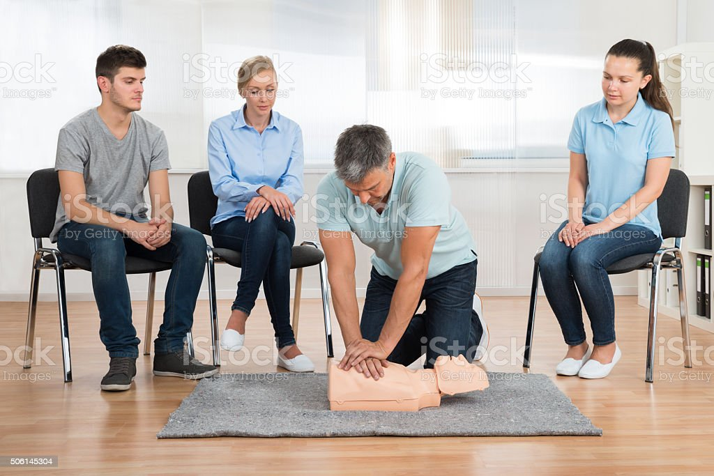 Instructor Teaching First Aid Cpr Technique stock photo