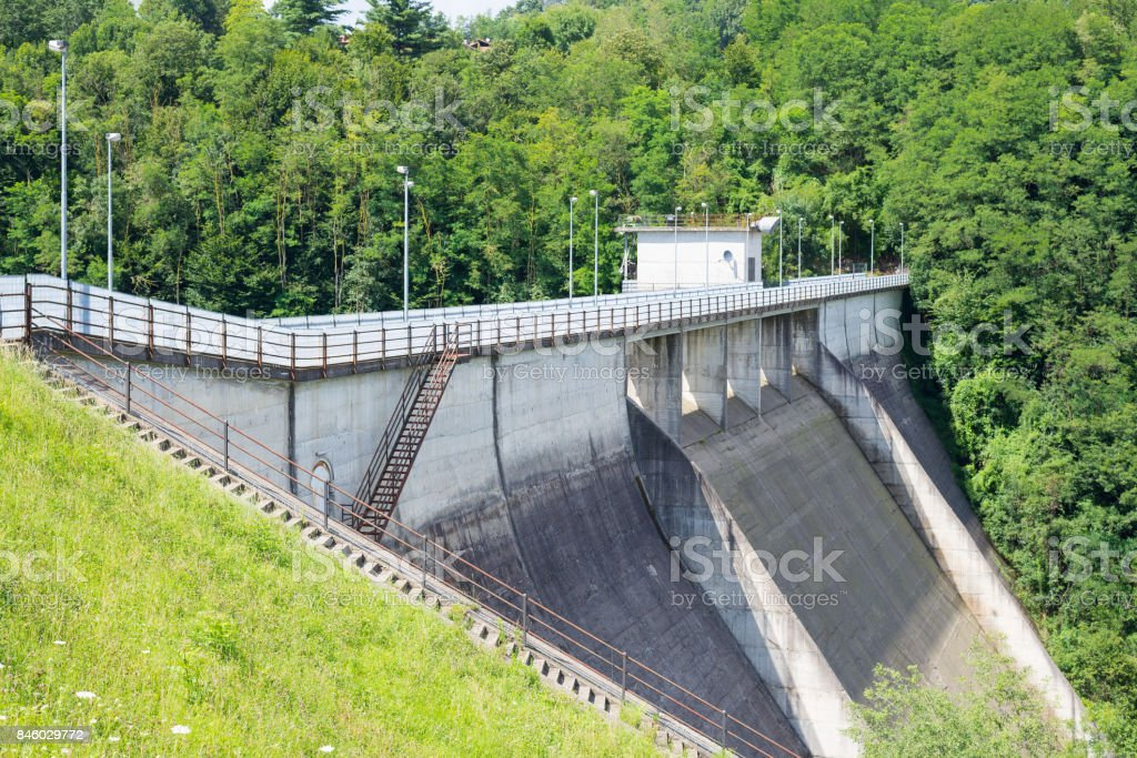 Instruments of measurement (strain gauge and topographic level) for stability monitoring on a dam. stock photo