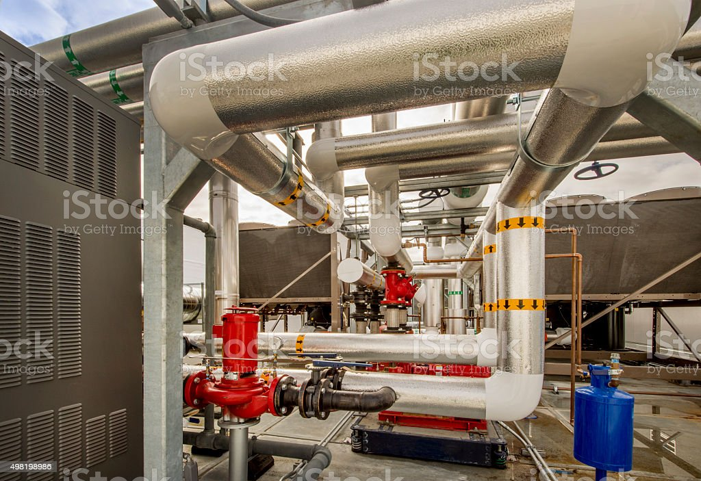 Insulated Pipes and Pumps for HVAC System stock photo