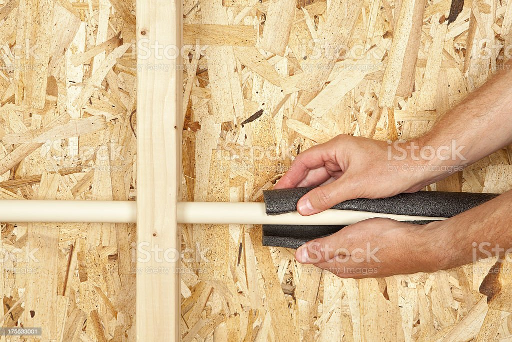 Insulating a Water Pipe stock photo