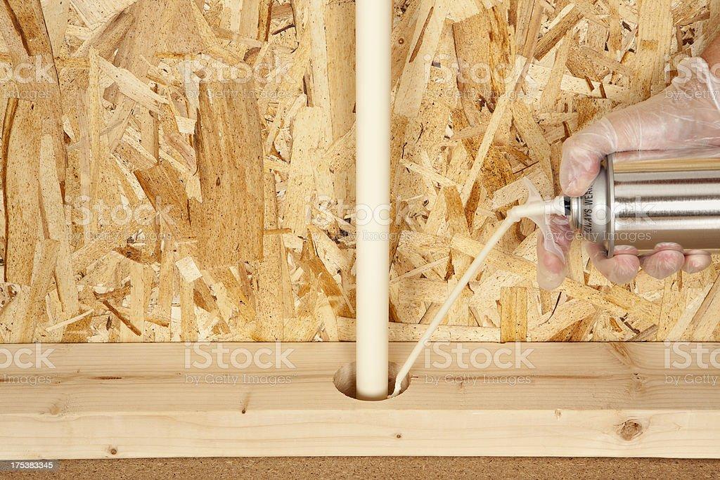 Insulating Foam Sealant Around Pipe stock photo