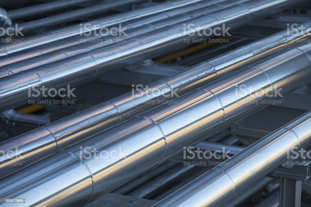 Insulation in Oil Refinery Steel Piping system stock photo