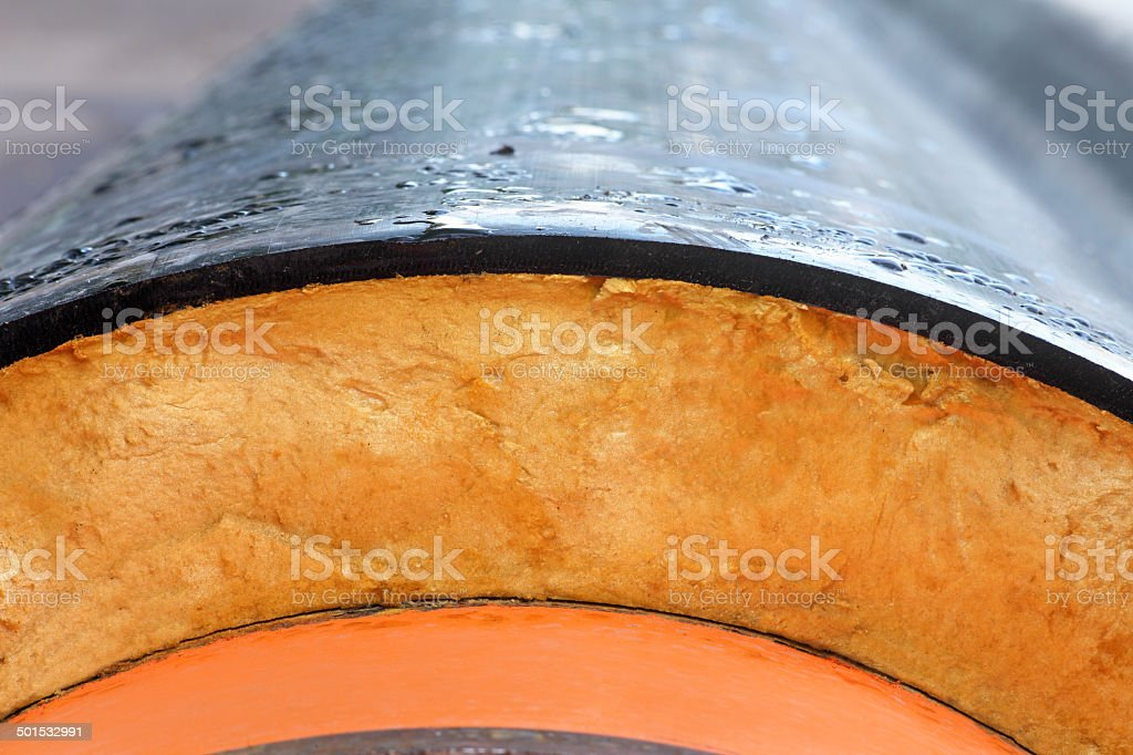 Insulation. Steel Pipe with Heat Insulation closeup. stock photo