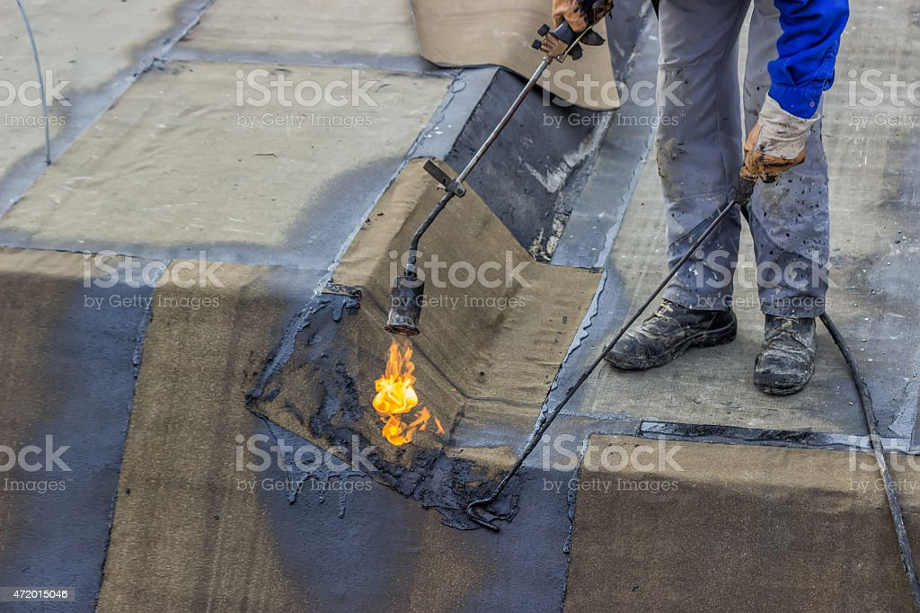 Insulation worker and propane blowtorch 3 stock photo