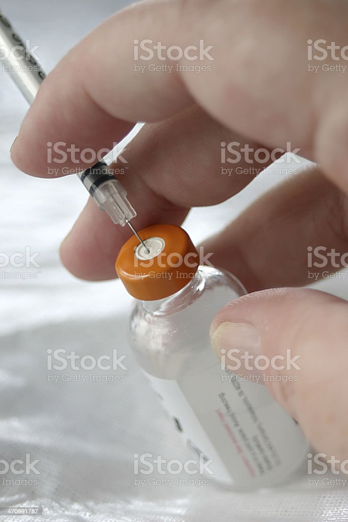 Insulin and syringe stock photo