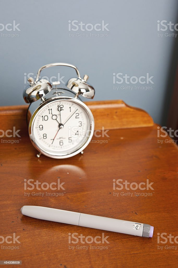 Insulin Pen and Glucometer on Night Stand royalty-free stock photo