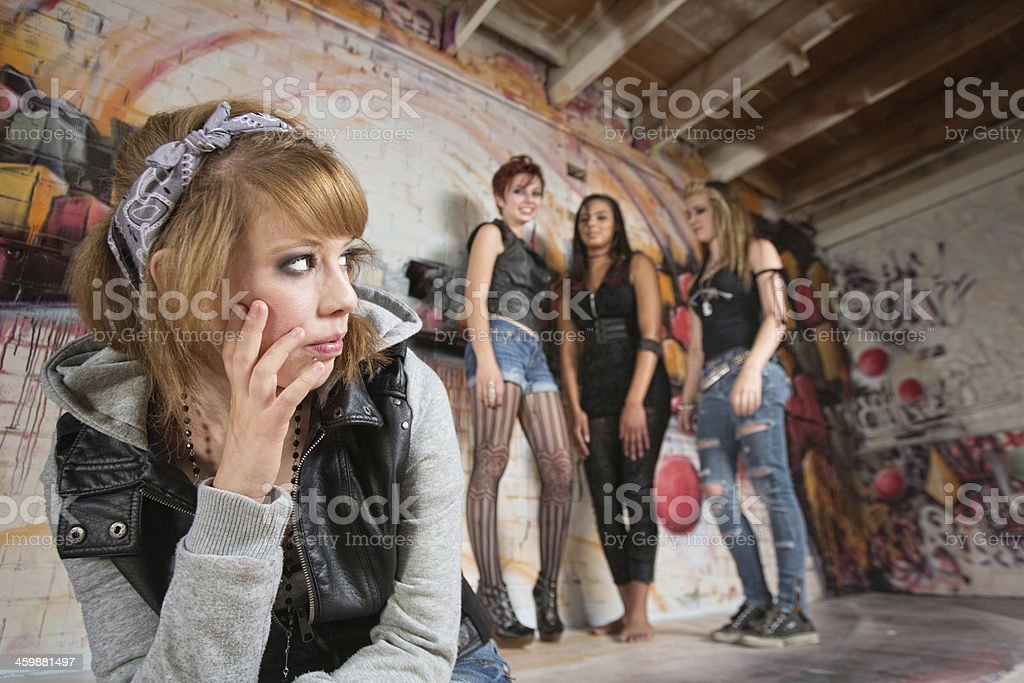 Insulted Girl Looking Over stock photo