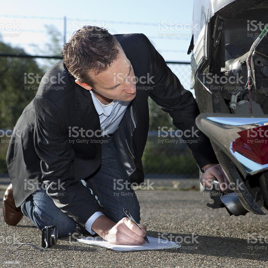Insurance adjuster inspecting car, claim form stock photo
