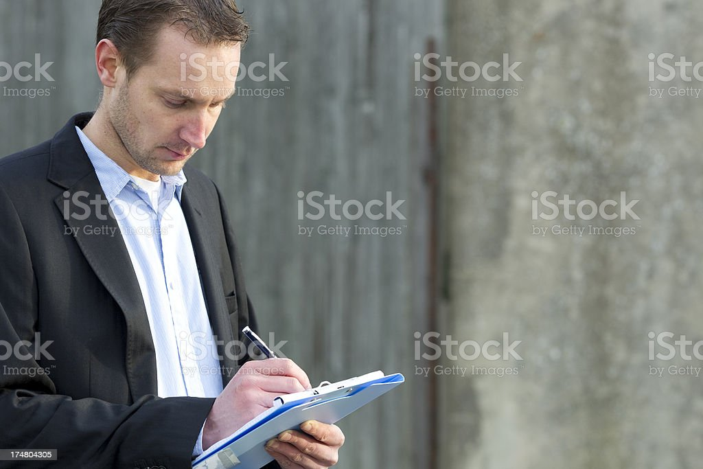 Insurance agent checking damage old house royalty-free stock photo