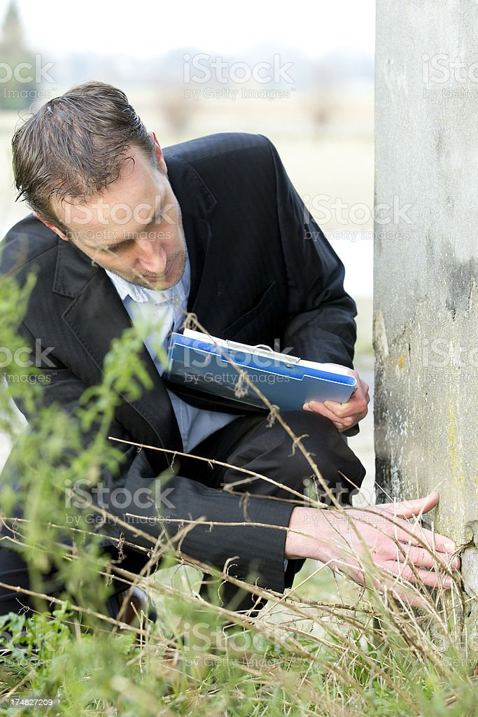 Insurance agent checking damage old house stock photo