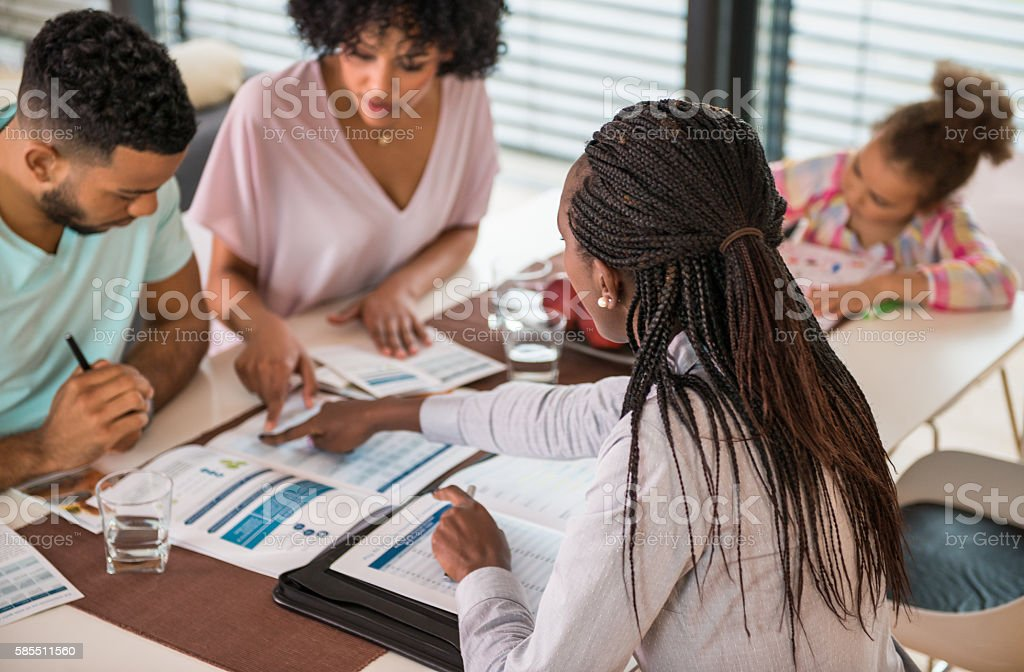 Insurance Agent Discussing With Couple stock photo