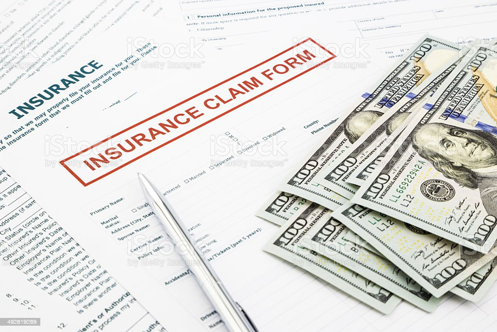 Insurance claim form and money stock photo