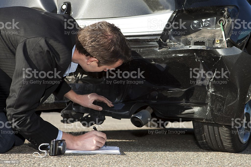 Insurance claim form, expert at work royalty-free stock photo