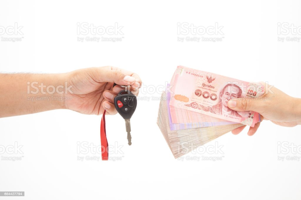 insurance concept, us banknote and car keys isolated on white background. stock photo