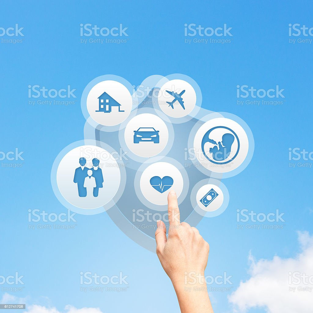Insurance concept with hand pressing a button stock photo