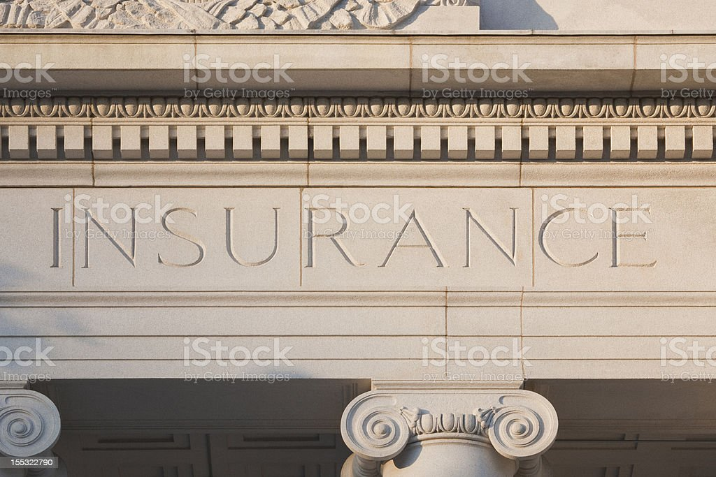 Insurance Etched into a Sandstone Building royalty-free stock photo