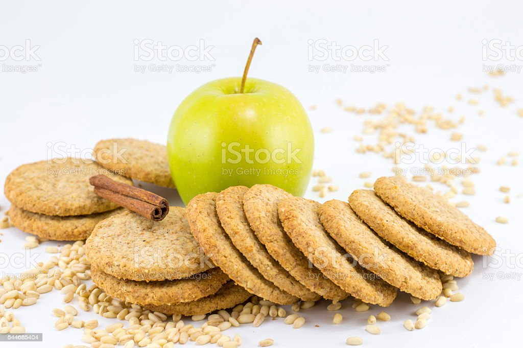 Integral biscuits with apple and wheat seeds stock photo