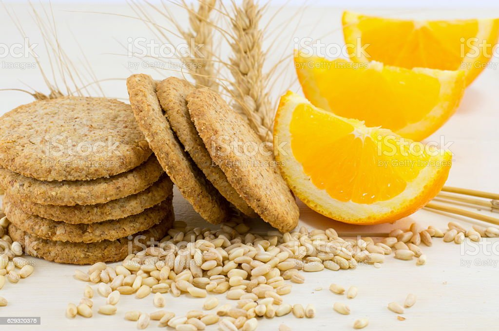 Integral biscuits with orange and wheat seeds stock photo