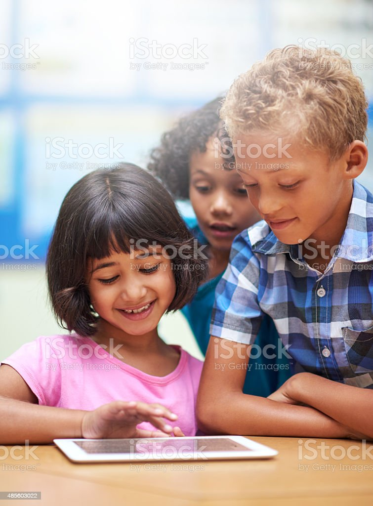 Integrating technology into their classroom stock photo