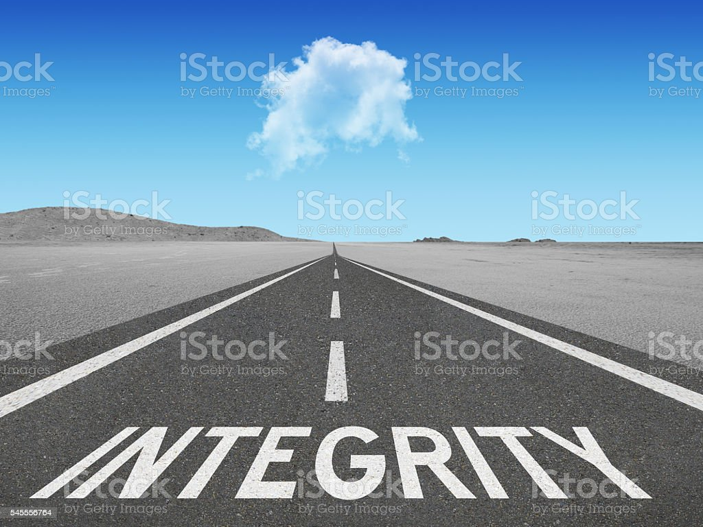 Integrity inspirational quote on highway stock photo