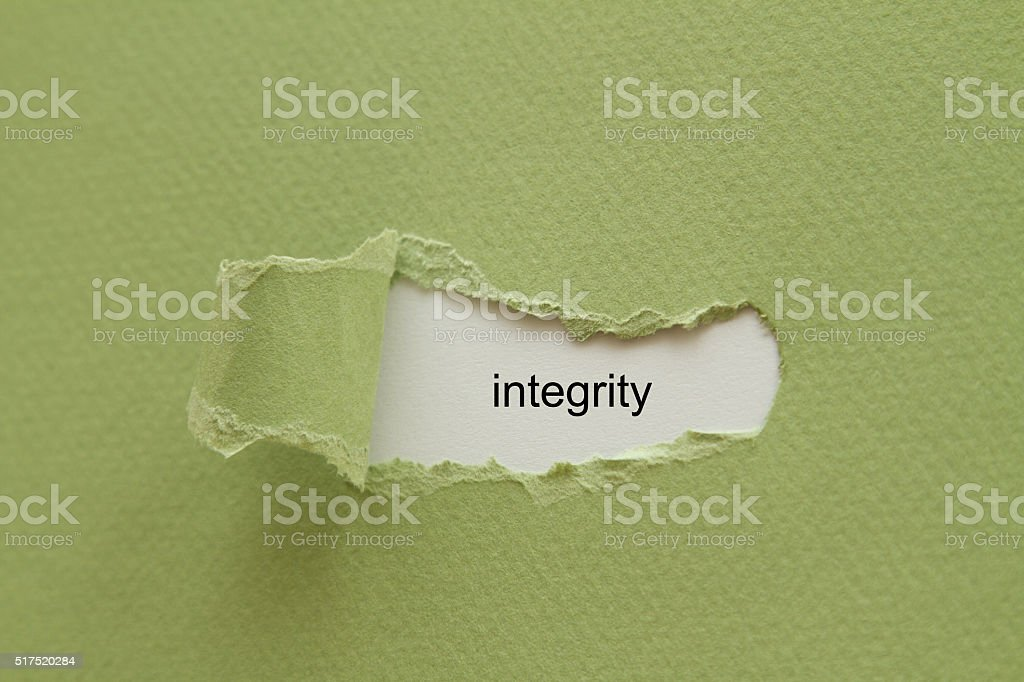 integrity word written under torn paper. stock photo