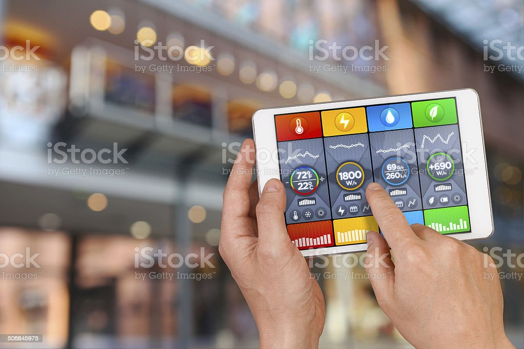 Intelligent building automation: controlling temperature, water, green energy consumption stock photo