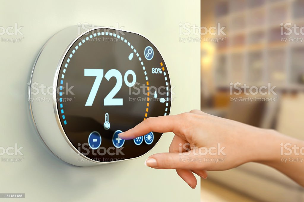 Intelligent home climate automation: choosing Fahrenheit temperature stock photo