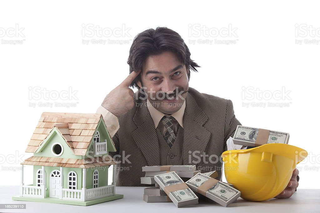 Intelligent man posing with dollar bills and model house royalty-free stock photo