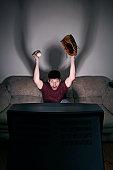 Intense Baseball Fan Watching Television