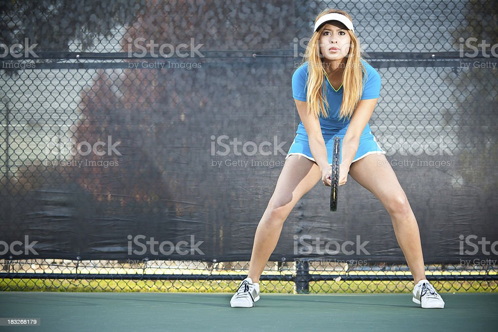 Intense Female Tennis Player Ready For Serve royalty-free stock photo