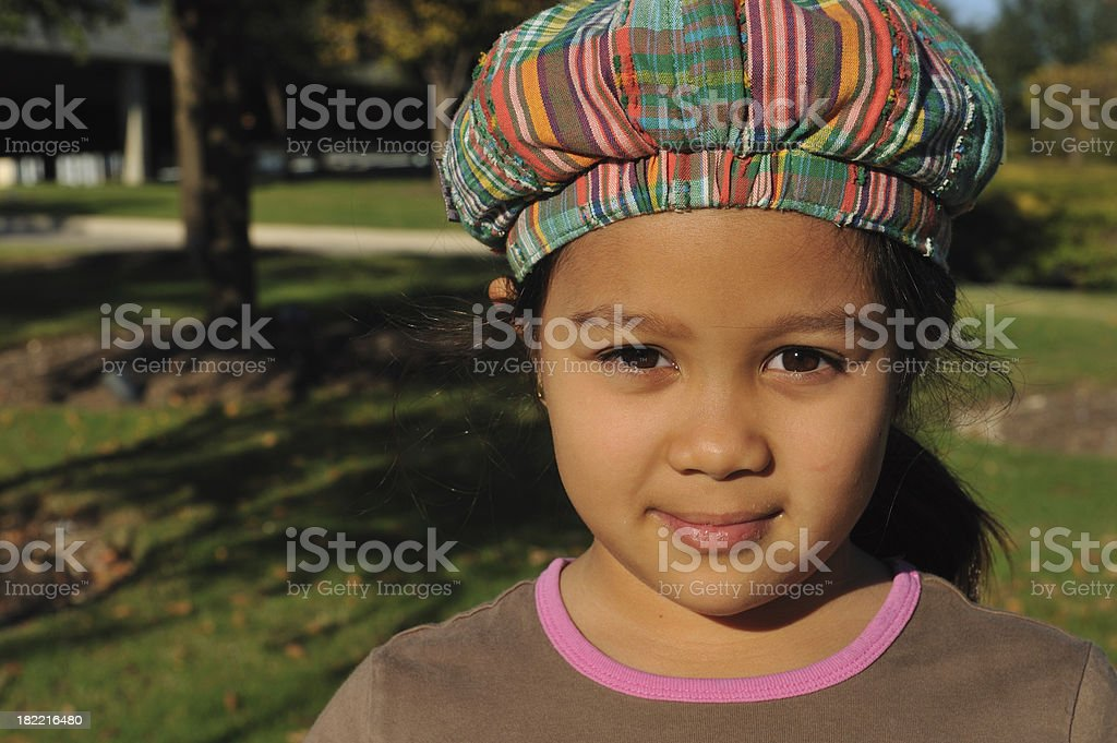 Intense gaze - little girl with hat on royalty-free stock photo