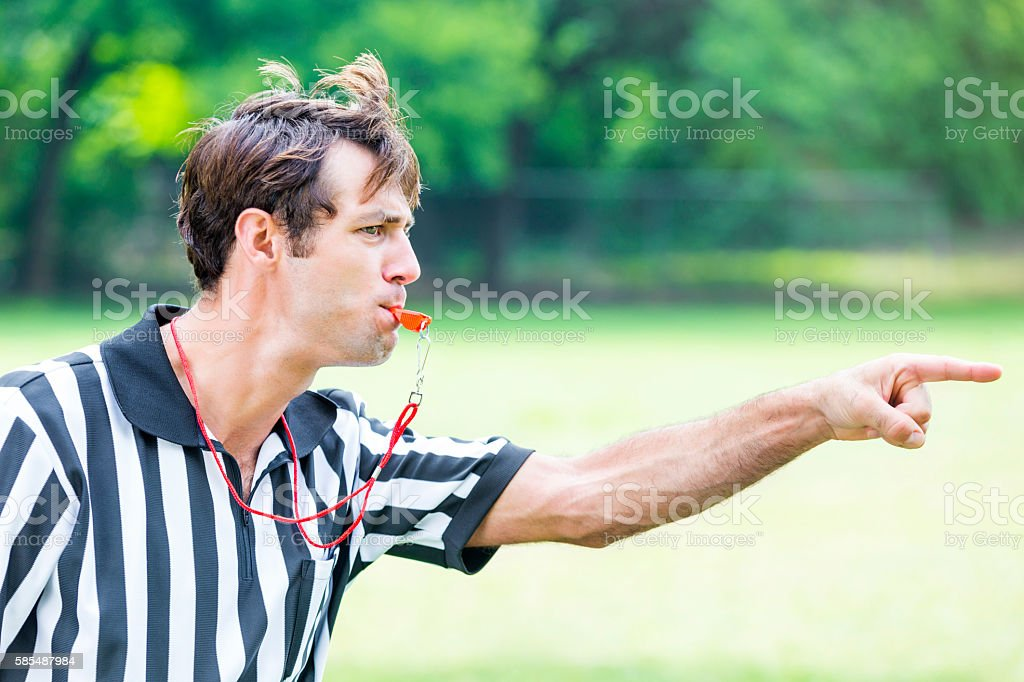 Intense referee calls penalty during sporting event stock photo