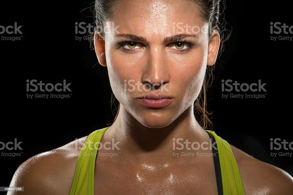 Intense stare eyes determined athlete champion glare headshot powerful stock photo