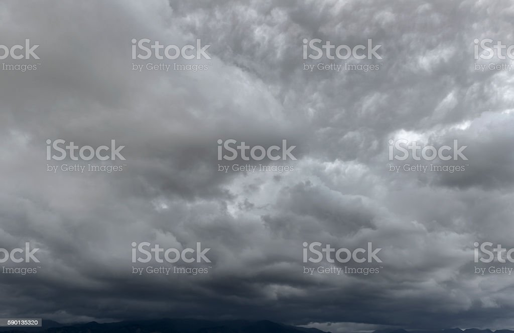 Intense thunderstorm over mountains stock photo