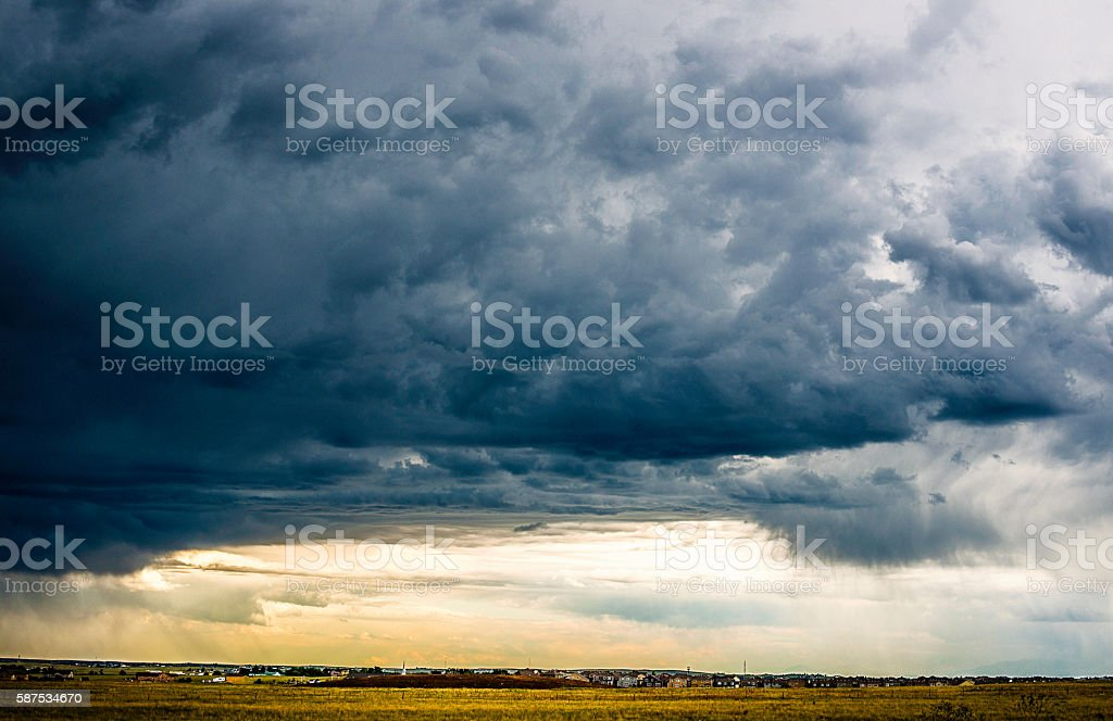 Intense thunderstorms with heavy clouds hover over Colorado neighborhood stock photo