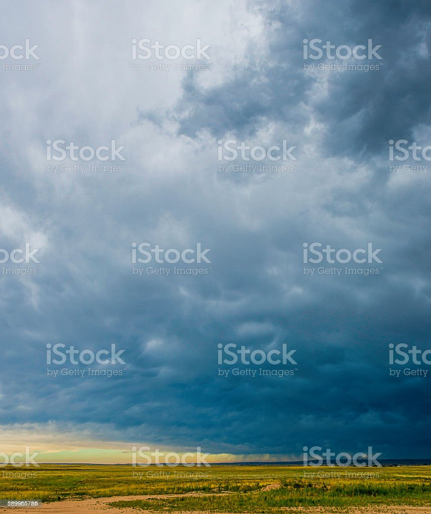 Intense thunderstorms with heavy clouds hover over Colorado plains stock photo