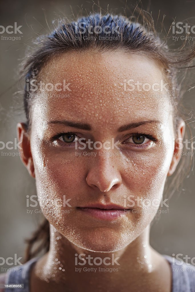 Intense young woman after working out royalty-free stock photo