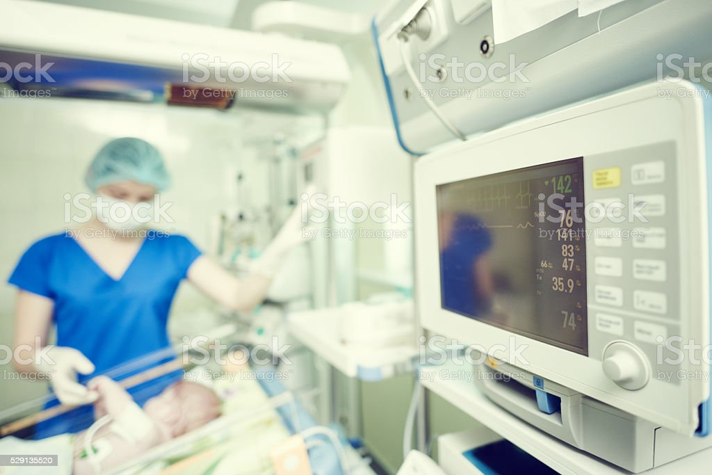 intensive care unit female doctor with baby infant stock photo