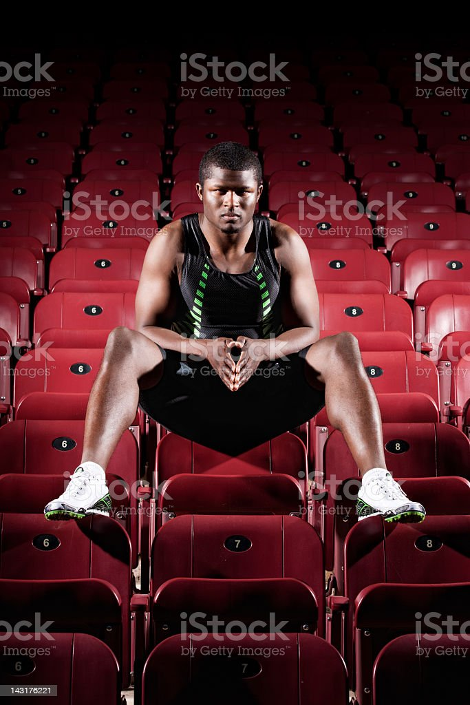 Intent Athlete in Stadium Seats royalty-free stock photo